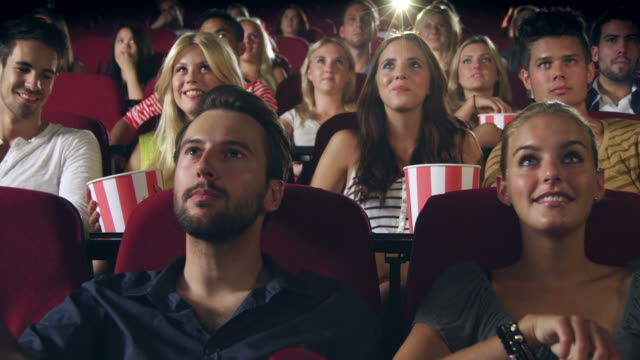 people watching movie - cinema stock videos and b-roll footage