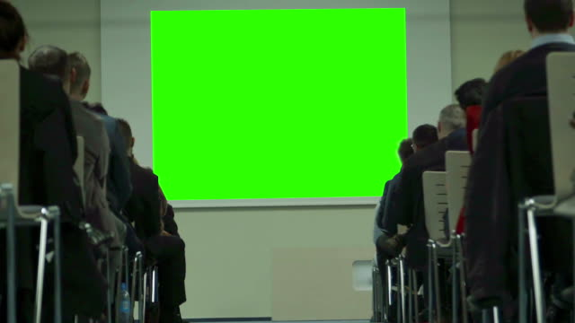 People Watching Screen. Green screen.