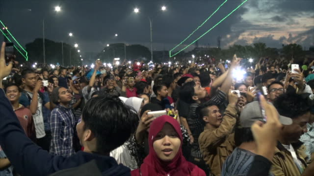 People watching the eclipse on The Ampera Bridge in Sumatra.