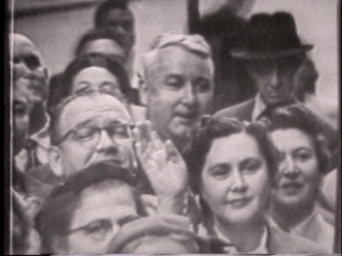 """people watching the today show being broadcast through a window on 49th st in rockefeller center. a person holds up a sign that reads """"maxine gordon""""... - 1955 stock-videos und b-roll-filmmaterial"""