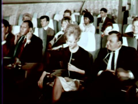ms cu people watching tv in airplane, portugal / audio - air stewardess stock videos & royalty-free footage