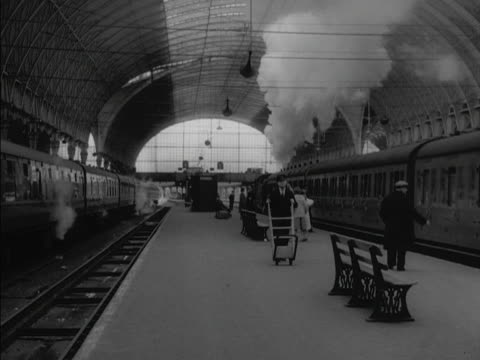 people wave off a steam train from a platform at paddington railway station - paddington railway station stock videos & royalty-free footage