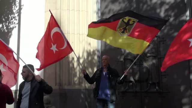 people wave turkish flags as they wait for the arrival of turkish president recep tayyip erdogan outside the ditib cologne central mosque and complex... - moschea video stock e b–roll