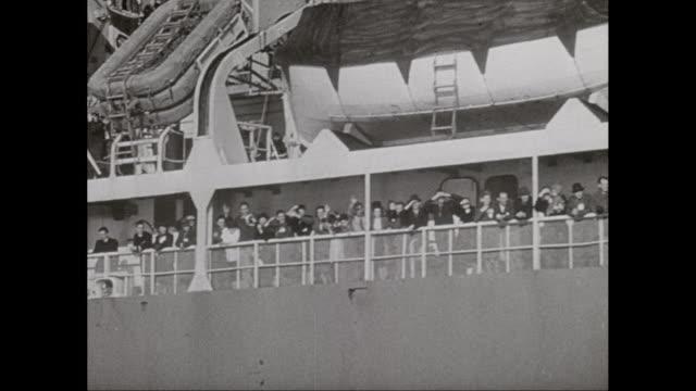 ms pov td people waving from passenger ship / united states - passagier wasserfahrzeug stock-videos und b-roll-filmmaterial
