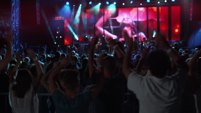 ds people waving hands at night concert in the open - video wall stock videos & royalty-free footage