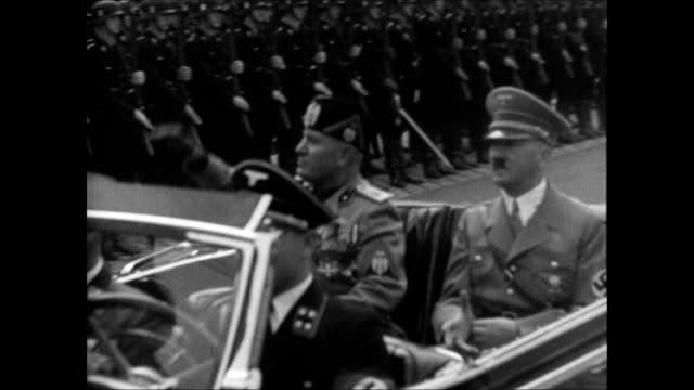 vídeos de stock, filmes e b-roll de people waving nazi flags line street, fascist dictator benito mussolini riding in convertible w/ nazi adolf hitler, hitler youth jugend waving. vs... - adolf hitler