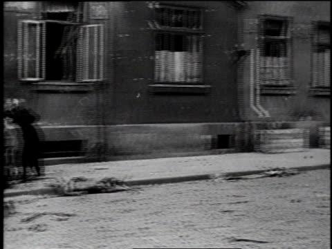 ws people waving white fabric near building with tanks on street / ws tanks driving on bridge / hamburg germany - zerstört stock-videos und b-roll-filmmaterial