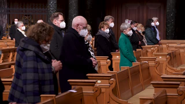 people wear ffp2 face masks and stand spaced far apart as they attend a good friday religious service during easter at the protestant berlin... - religious service stock videos & royalty-free footage
