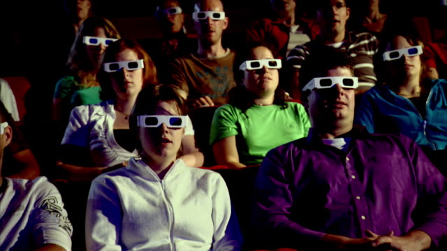 ms people wearing 3d glasses in theatre  - 3d glasses stock videos & royalty-free footage