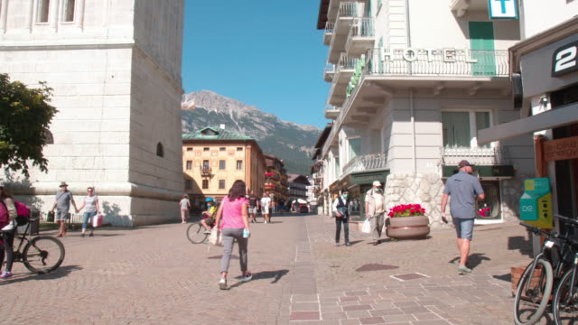 people wearing a protective masks walk in cortina d'ampezzo italy amid the covid19 pandemic - cortina stock videos & royalty-free footage