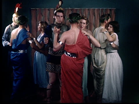 WS, People wearing ancient Roman costumes dancing on party, 1950's, Oklahoma, USA
