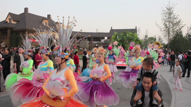 ws people wearing colorful costumes and parade float/xian,shaanxi,china - fancy dress costume stock videos and b-roll footage
