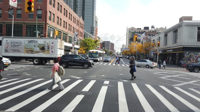 people wearing face mask crossing street in harlem, new york city amidst the 2020 global coronavirus pandemic. - protection stock videos & royalty-free footage