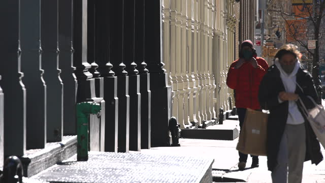 people wearing face mask walks on the street in soho district amidst pandemic of covid-19. - loft apartment stock videos & royalty-free footage