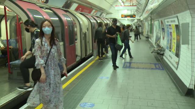 people wearing face masks during coronavirus pandemic on london underground - safety stock videos & royalty-free footage