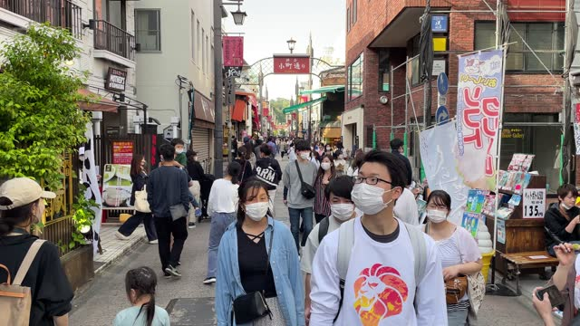 people wearing face masks walk along a busy shopping street on may 4, 2021 in kamakura, japan. as japan enjoys its annual golden week holiday a... - japan stock videos & royalty-free footage