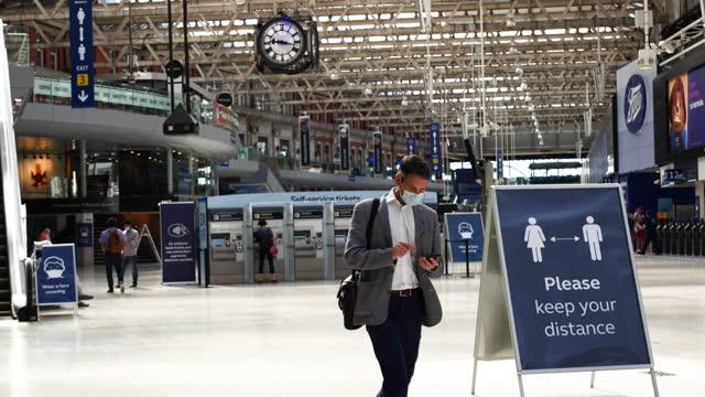 people wearing face masks walk at waterloo national rail station in morning rush hour during covid-19 coronavirus pandemic in london, england, uk, on... - epidemic stock videos & royalty-free footage