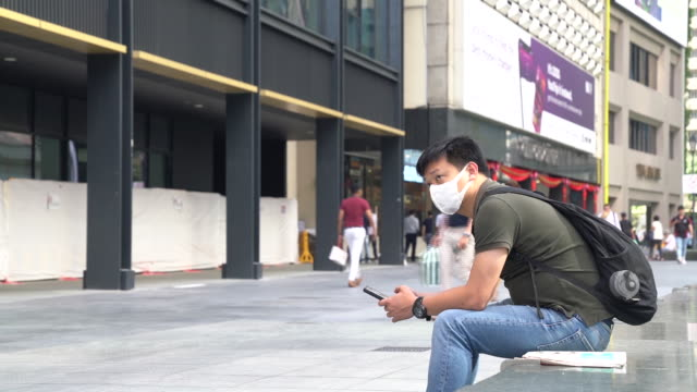 people wearing masks as a precaution for coronavirus outbreak in singapore city, singapore, on friday, january 31, 2020. - singapore stock videos & royalty-free footage