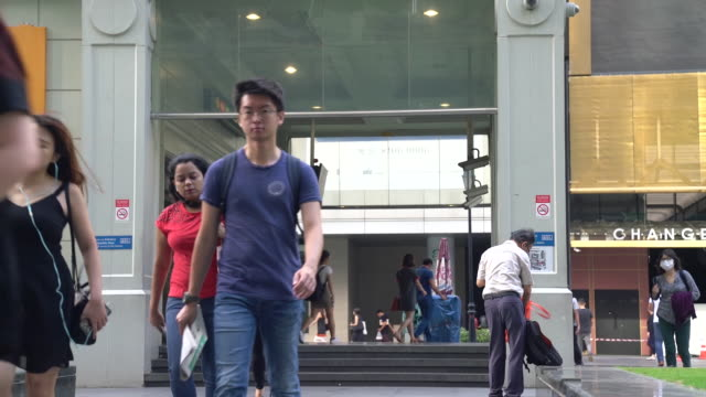 people wearing masks as a precaution for coronavirus outbreak in singapore city, singapore, on friday, january 31, 2020. - raffles city stock videos & royalty-free footage