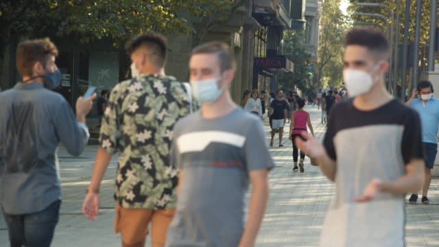 people wearing masks at barcelona spain. new normal city life during summer 2020 - b roll stock videos & royalty-free footage