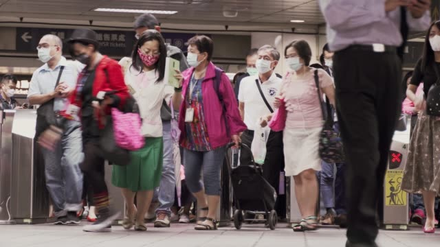 people wearing masks walking in the station during the covid-19 breakout - taiwan stock videos & royalty-free footage