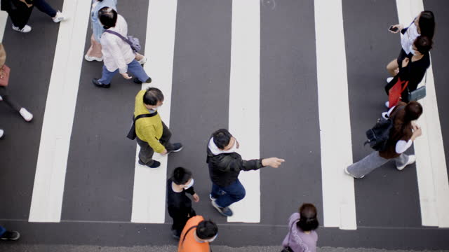 people wearing masks walking on zebra crossing - road marking stock videos & royalty-free footage