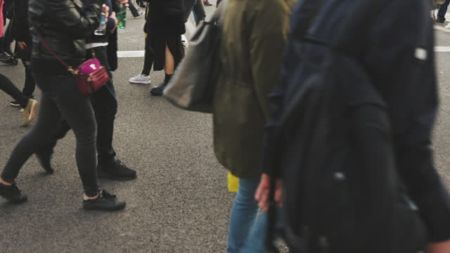 people wearing masks walking on zebra crossing - crossing stock videos & royalty-free footage