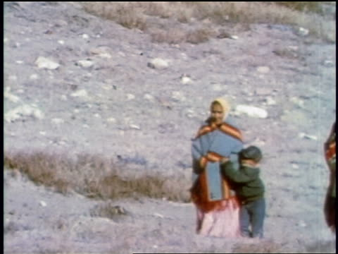 1957 people wearing native dress + brightly colored blankets walking outdoors / may be south america - 1957 stock videos & royalty-free footage