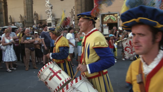 ms pan people wearing period costumes walking in parade playing instruments, scoppio del carro festival / florence, italy - parade stock videos & royalty-free footage