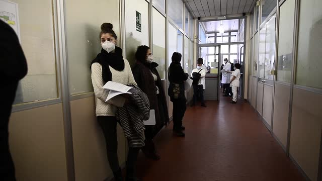 people wearing protective mask awaits a covid 19 vaccine at amedeo di savoia hospital on december 27, 2020 in turin, italy. the first vaccination for... - italy stock videos & royalty-free footage