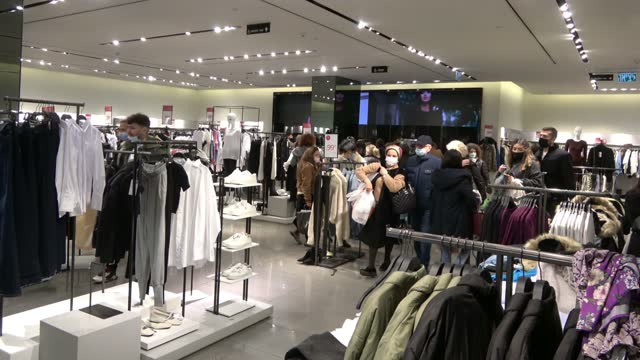 people wearing protective masks due to the coronavirus pandemic buy clothes in a clothing store in mamilla mall on february 21 in jerusalem, israel.... - economy stock videos & royalty-free footage