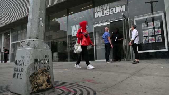 stockvideo's en b-roll-footage met people wearing protective masks get their temperatures taken before entering the newly reopened new museum of contemporary art on manhattan's lower... - new jersey