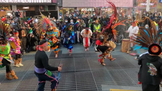 people wearing protective masks watch as grupo tolteca chichimeca celebrates dia de los muertos in times square on october 31, 2020 in new york city. - dia stock videos & royalty-free footage