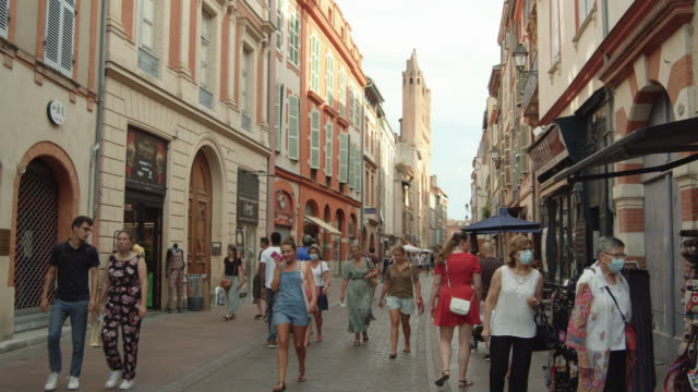 people wearing surgical mask at french town street. toulouse during covid pandemic. august 2020 - toulouse stock videos & royalty-free footage