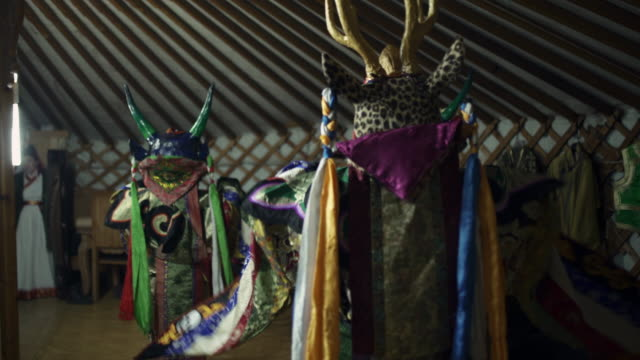 people wearing traditional tibetan buddhist masks in ger - northern countryside, mongolia - film festival stock videos & royalty-free footage
