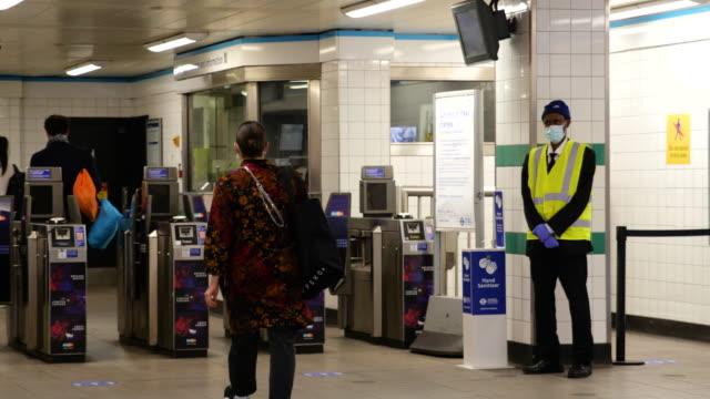 people wearing virus masks enter brixton underground station during lockdown for coronavirus pandemic in london, england, uk, on saturday, june 20,... - station stock videos & royalty-free footage