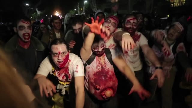 people wearing zombie costumes and face paint took to the streets of tel aviv on saturday to take part in a zombie walk part of festivities for the... - zombie stock videos & royalty-free footage