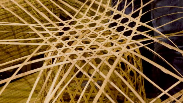 4k people weaving bamboo basket - tessere video stock e b–roll