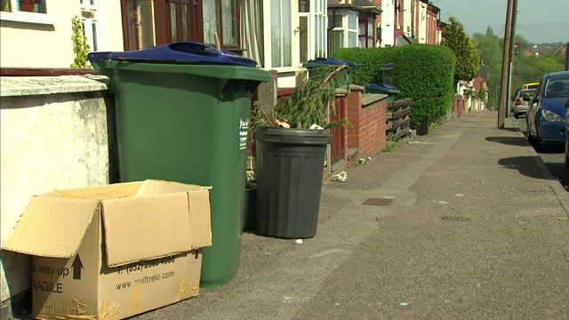 people who break the rules on rubbish collections will no longer be fined the government says it's going to scrap penalties in england for offences... - rules stock videos & royalty-free footage