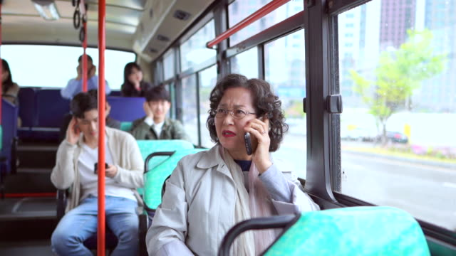 people who dislike a middle-aged woman talking loudly on the bus (public transportation etiquette campaign) - korean ethnicity stock videos & royalty-free footage