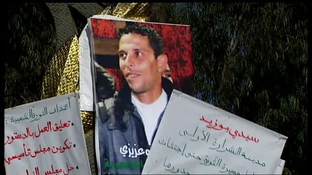 People who have made the greatest impact in 2011 Mohamed Bouazizi nominated by Jonathan Rugman T20011118 Sidi Bouzid EXT Shots of protest posters...