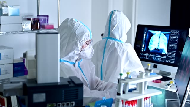 people who research viruses at the corona virus research institute. - epidemiology stock videos & royalty-free footage