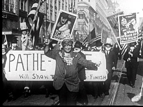 b/w 1918 people with banners wearing flu masks marching in liberty loan parade / newsreel - 1918 stock videos & royalty-free footage