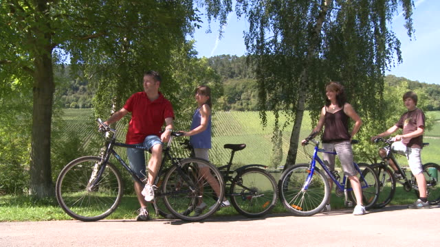 ws people with bicycles at mosel valley / nittel, rhineland-palatinate, germany                              - family waving stock videos & royalty-free footage