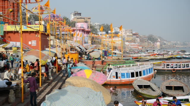 WS People with boats at Ganges river / Varanasi, Utter Pradesh, India