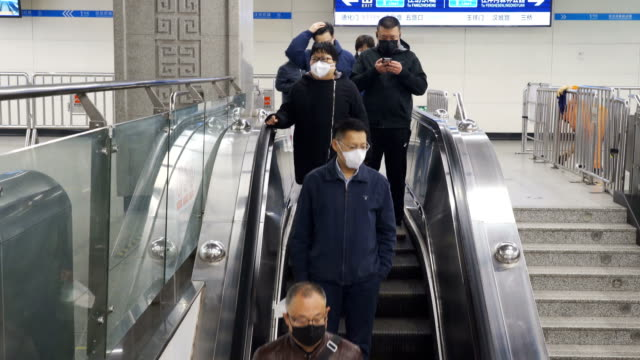 people with face mask protection from covid-19 in metro station,xi'an,china. - full length stock videos & royalty-free footage