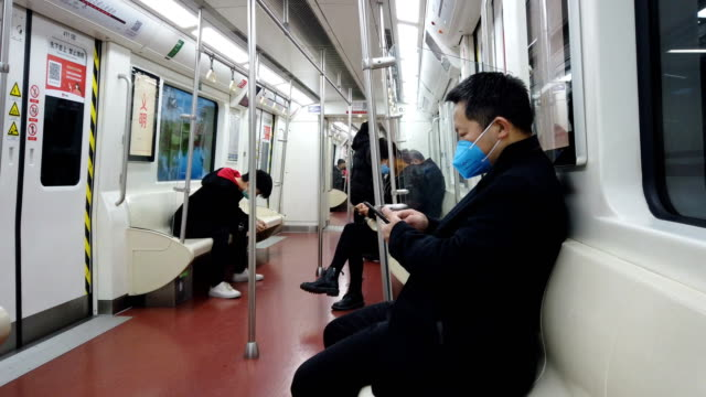 people with face mask protection from covid-19 in metro,xi'an,china. - 感染症点の映像素材/bロール