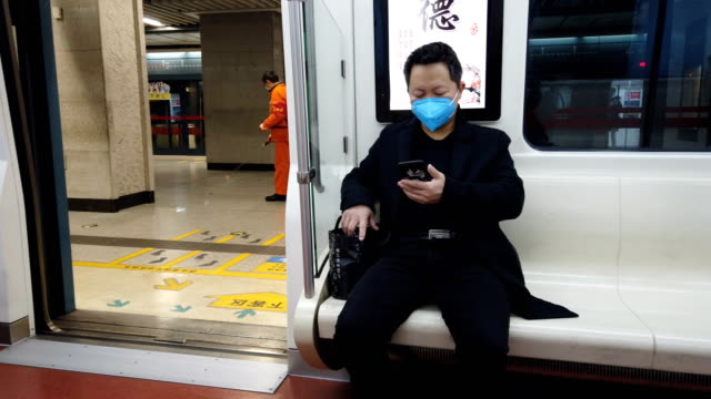 people with face mask protection from covid-19 in metro,xi'an,china. - protective workwear stock videos & royalty-free footage