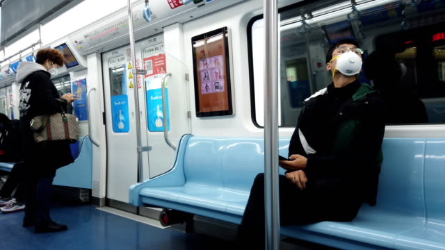 people with face mask protection in metro station,xi'an,china. - epidemic stock videos & royalty-free footage
