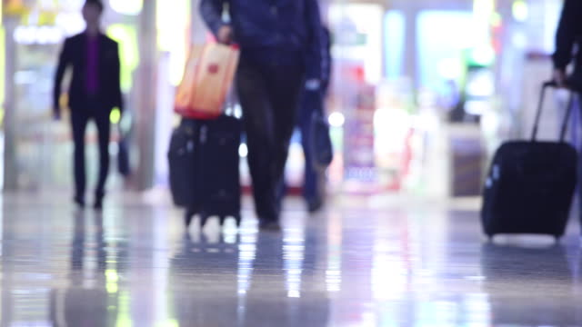 people with luggage walking in airport - luggage stock videos & royalty-free footage